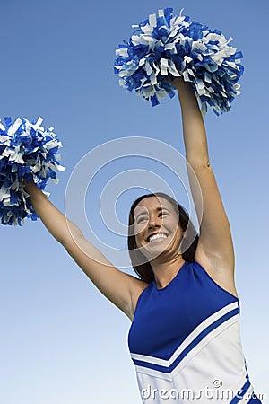 Smiling Cheerleader rising pom-poms