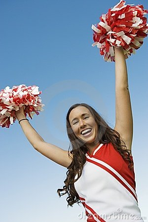 Smiling Cheerleader rising pom-poms