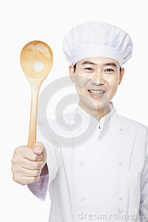 Free Smiling Chef Holding Wooden Spoon, Studio Shot Royalty Free Stock Images - 31108359