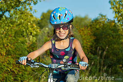 Smiling child on bicycle