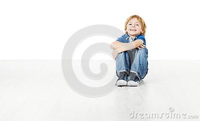 Smiling child sitting on white floor