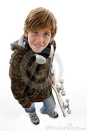Smiling child with skateboard and headphone