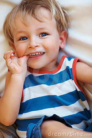 Smiling child with thumb in mouth