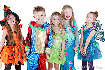 Smiling children in carnival costumes  stand