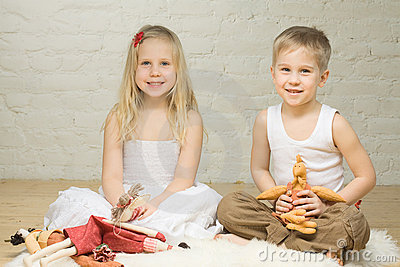 Smiling children playing with stuffed animals