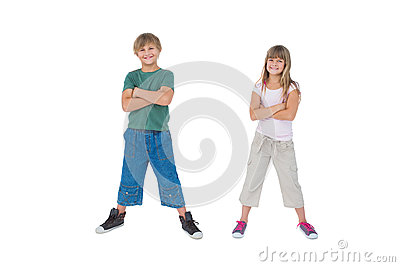 Smiling children with their arms crossed