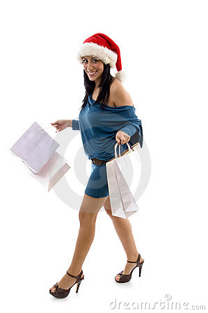 Smiling christmas female holding carry bags