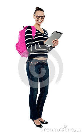 Smiling college girl using tablet pc
