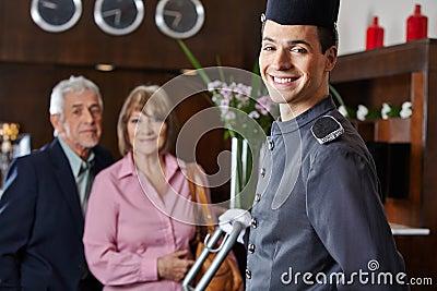 Smiling concierge with senior couple