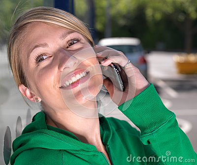 Smiling,confident blond woman on mobile phone