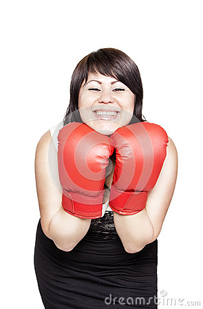 Smiling confident woman with boxing gloves