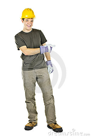 Smiling construction worker pointing to the side