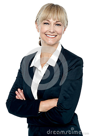 Smiling corporate head posing with folded arms