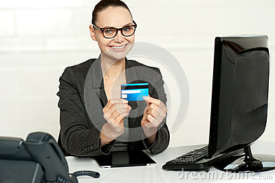 Smiling corporate lady showing credit card