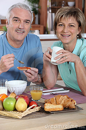 Smiling couple at breakfast