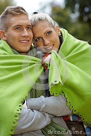 Smiling couple on cold autumn day outdoors