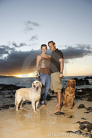 Smiling Couple With Dogs at the Beach