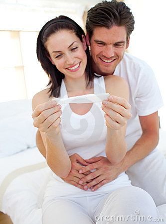 Smiling couple finding results of pregnancy test