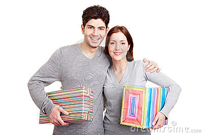 Smiling couple with gifts