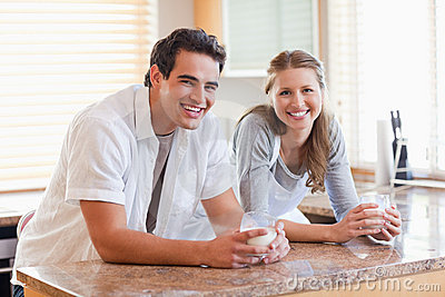 Smiling couple with glasses of milk