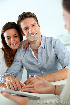 Smiling couple happy to buy new home