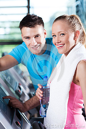 Smiling couple in health club