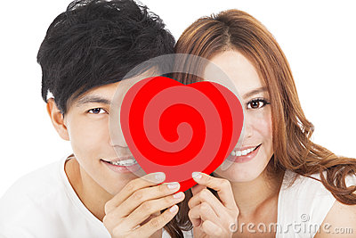 Smiling couple holding the love sign