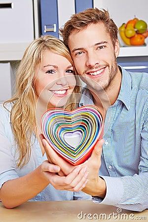 Free Smiling Couple Holding Many Hearts Royalty Free Stock Photo - 28288635