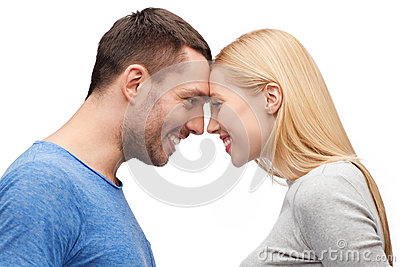 Smiling couple looking at each other