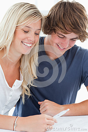 Smiling couple looking at the result of a pregnancy test
