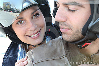 Smiling couple on a motorbike