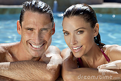 Smiling Couple Relaxing In Swimming Pool