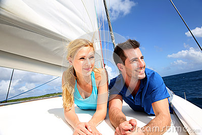 Smiling couple relaxing on a yacht