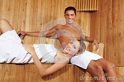 Smiling couple in sauna