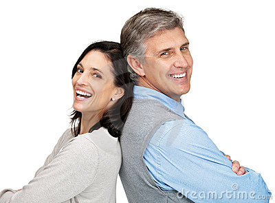 Smiling couple standing back to back on white