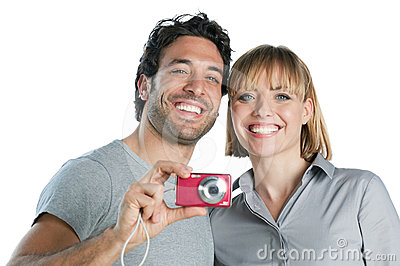 Smiling couple taking photos