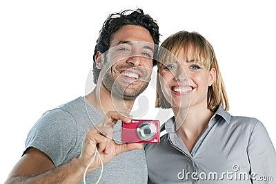 Smiling couple taking photos