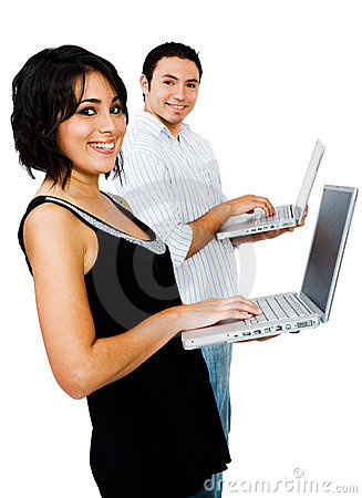 Smiling couple using laptops