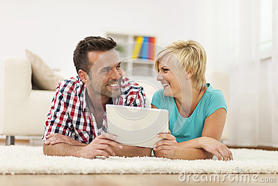Smiling couple using tablet