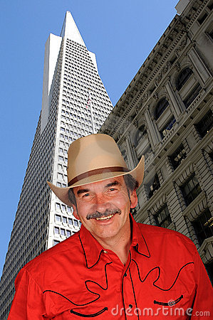 Smiling cowboy in city