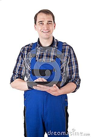 Smiling craftsman with digital tablet