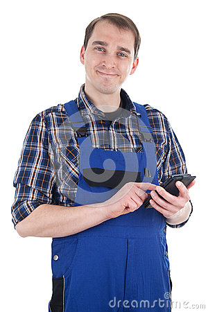 Smiling craftsman with smart phone