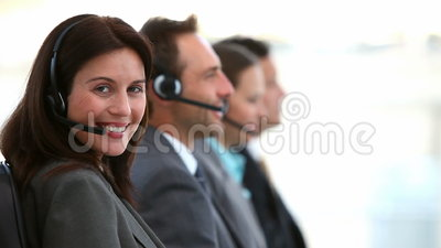 Smiling customer service agents working in a call center Stock Photo
