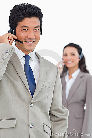 Smiling customer support employee with colleague