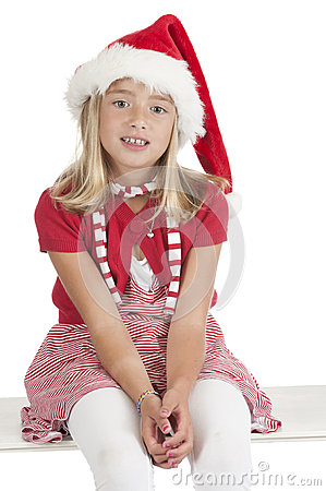 Smiling cute blond girl with christmas hat
