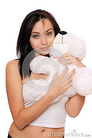 Smiling cute girl with a teddybear