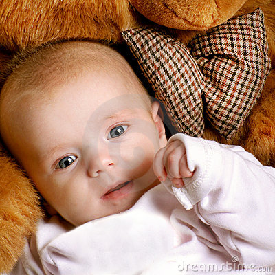 Smiling Cute infant with a bear