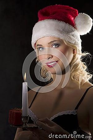 Smiling cute santa claus in the dark