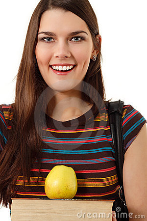 Smiling cute teen student girl with book and apple