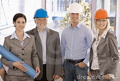 Smiling designer team wearing hardhat